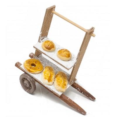 Miniatura di un carretto a due piani con pane