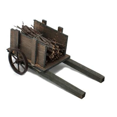 miniatura di un carretto con legna per presepe